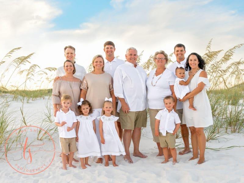tina smith destin photographer family beach portrait wearing tan shorts and white