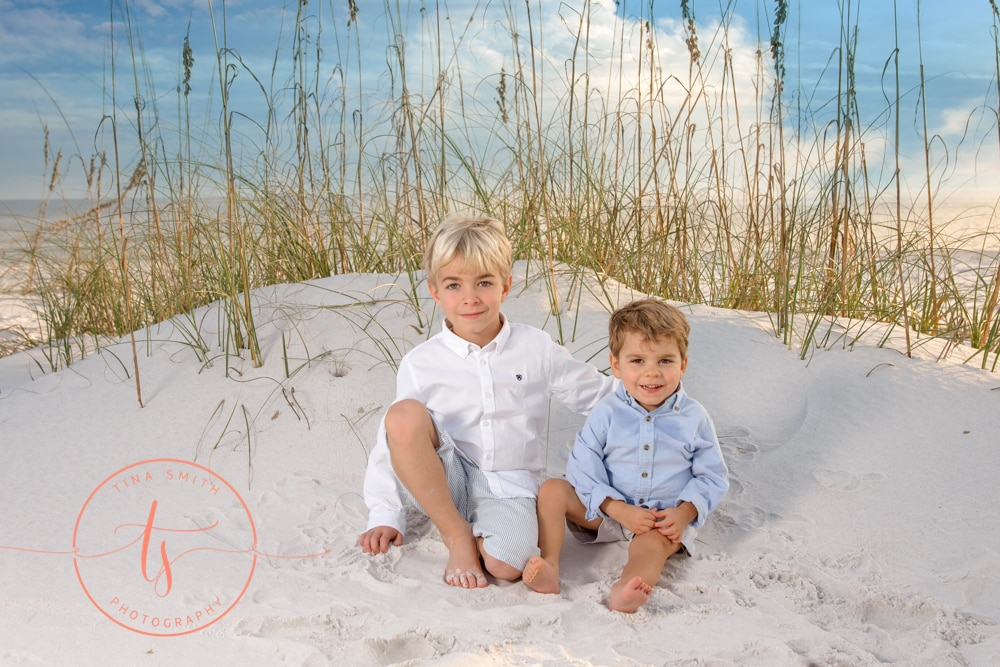 Destin photographer capturing portrait of kids on sand dune