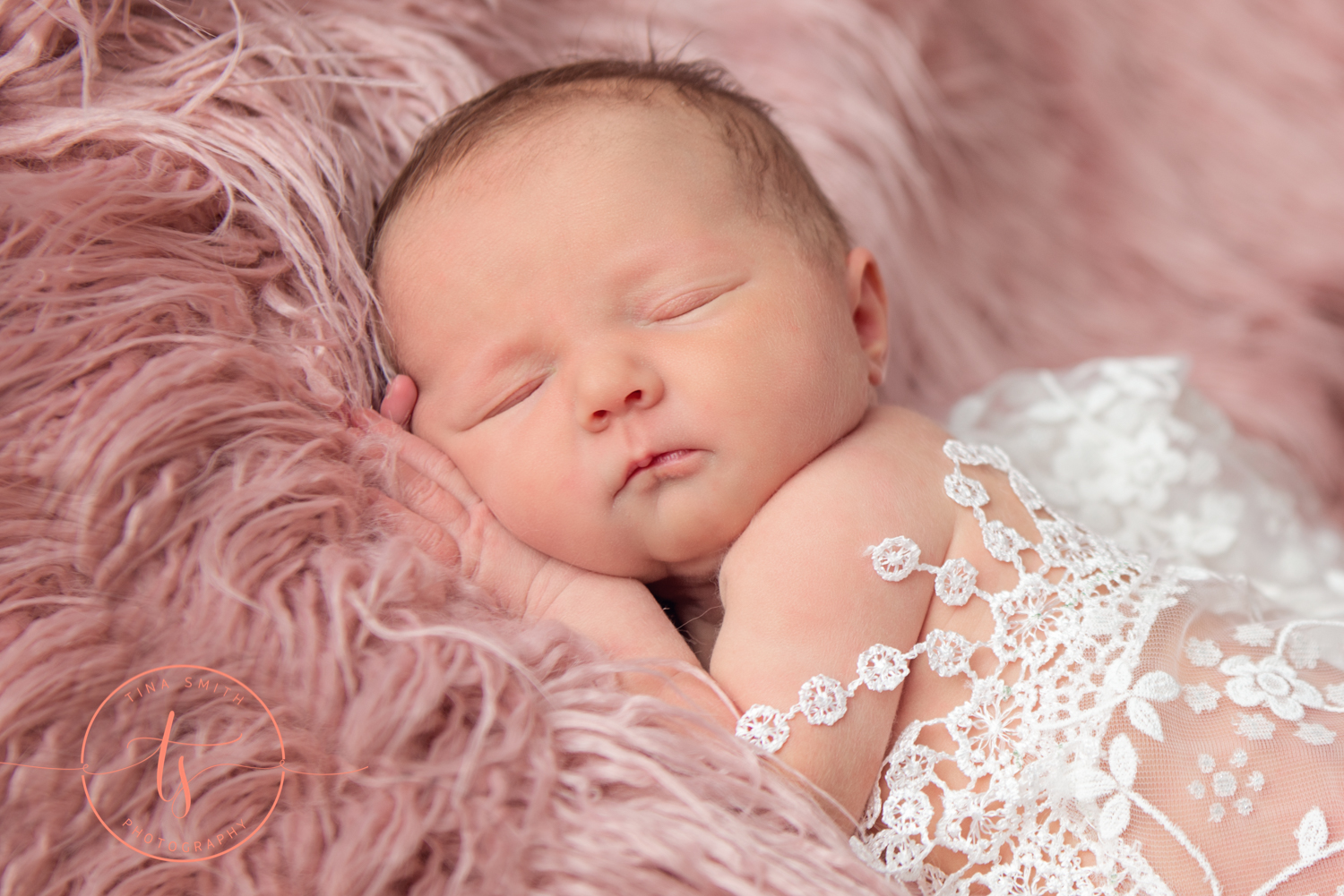 newborn baby photography pink fur white lace wrap