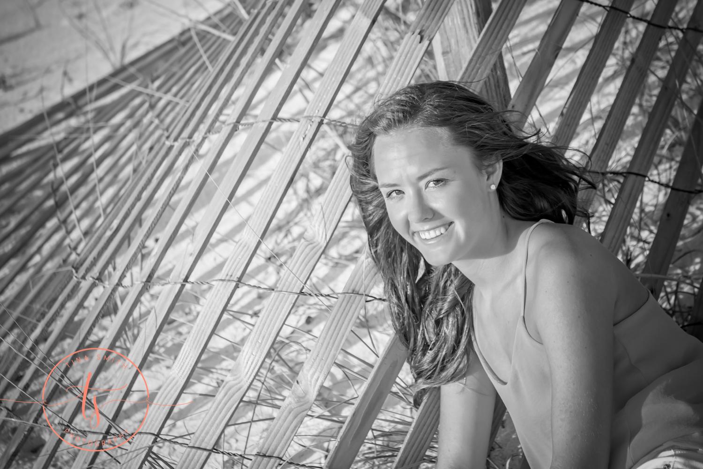 girl posing for senior portraits on beach in destin