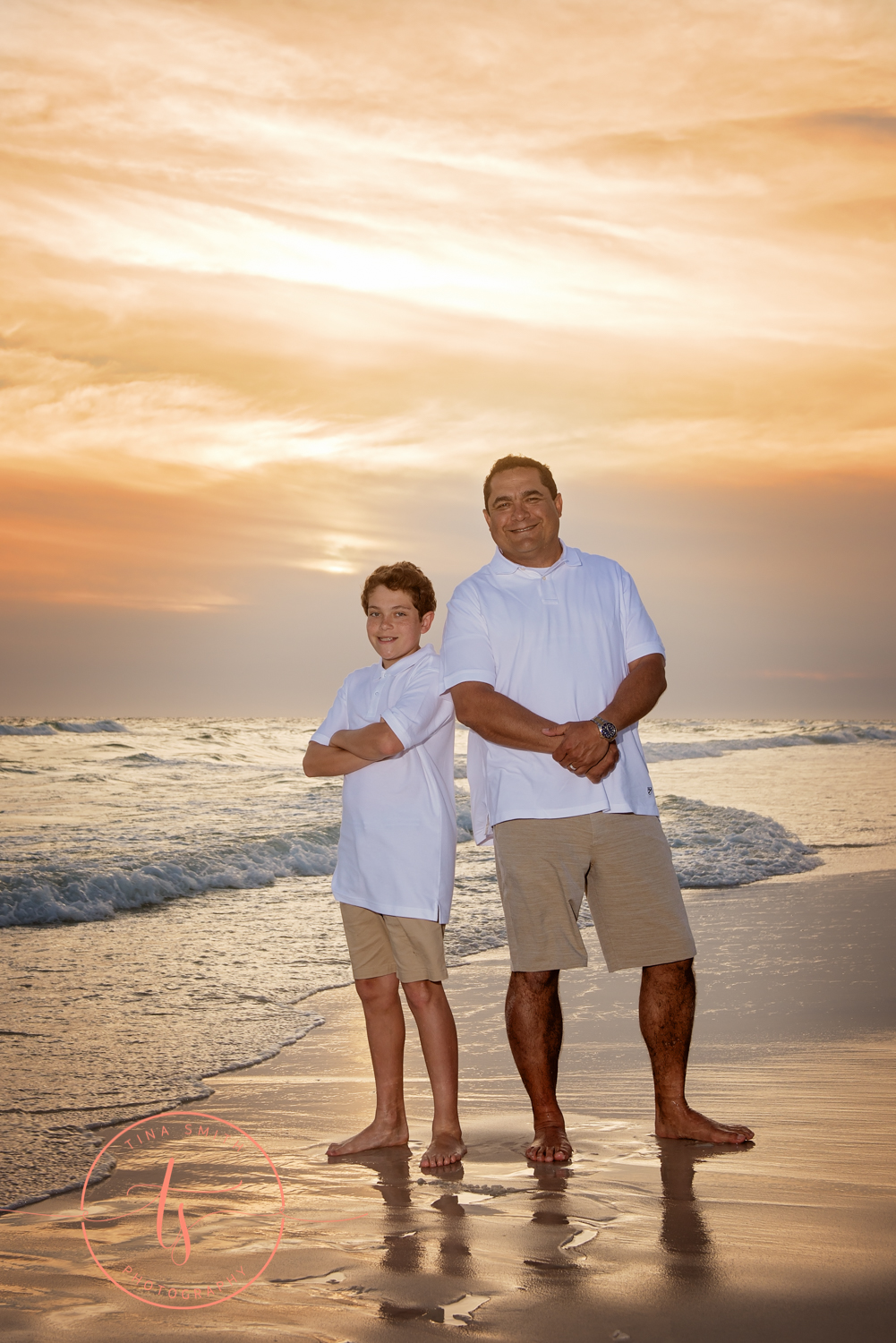 dad and son posing at sunset on watersound beach photographer