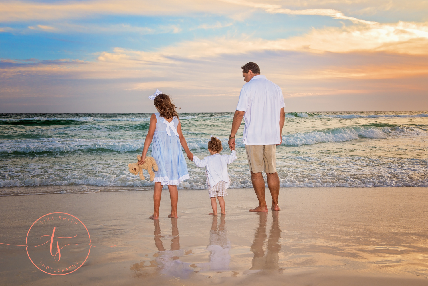 dad and daughters holding hands on watersound beach 30A