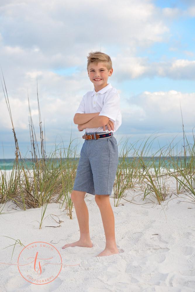 boy standing on beach in destin