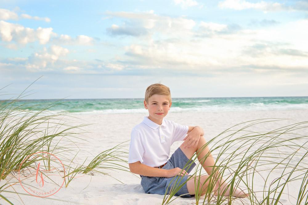 boy sitting on beach in destin