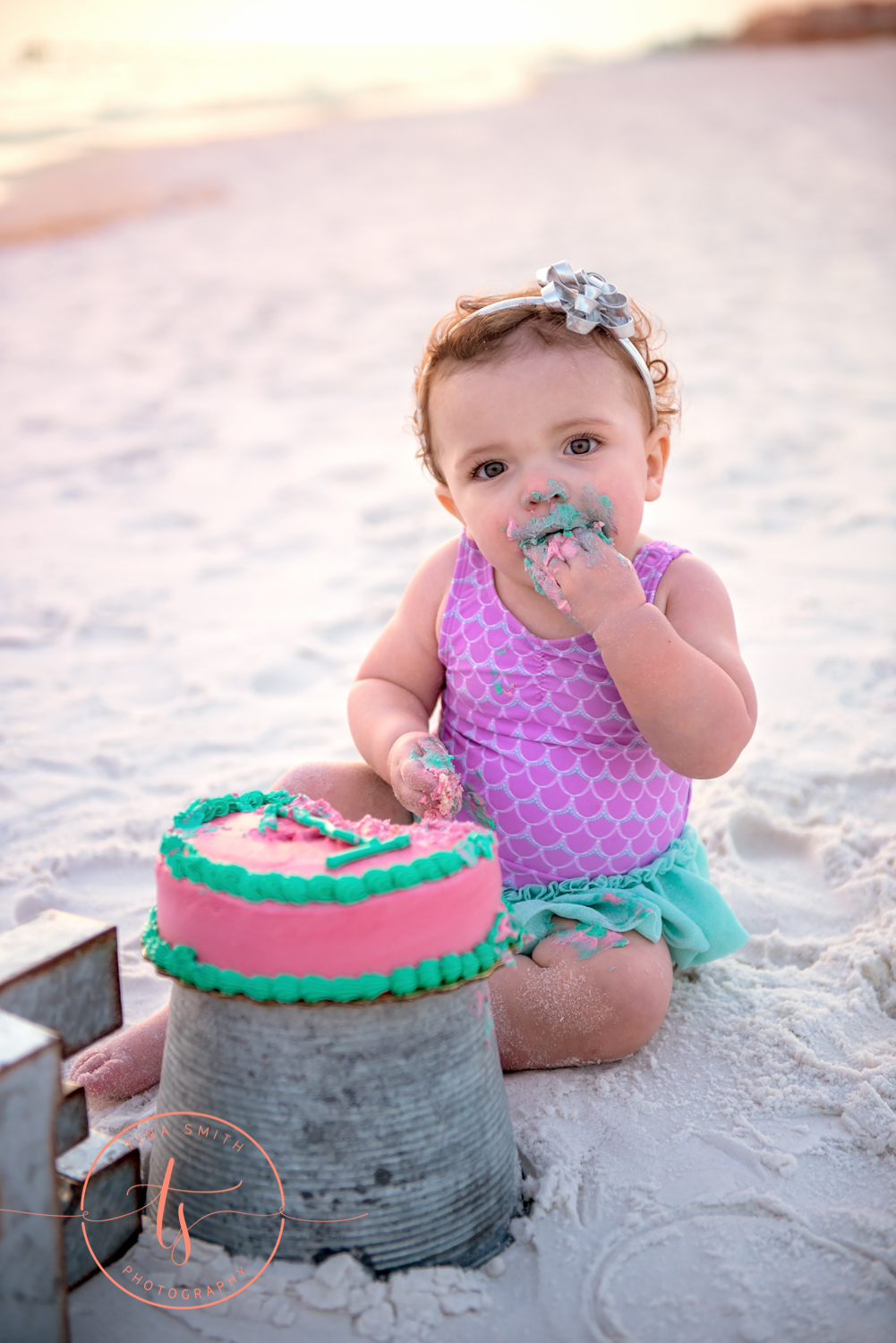 baby eating cake on beach in destin for portraits