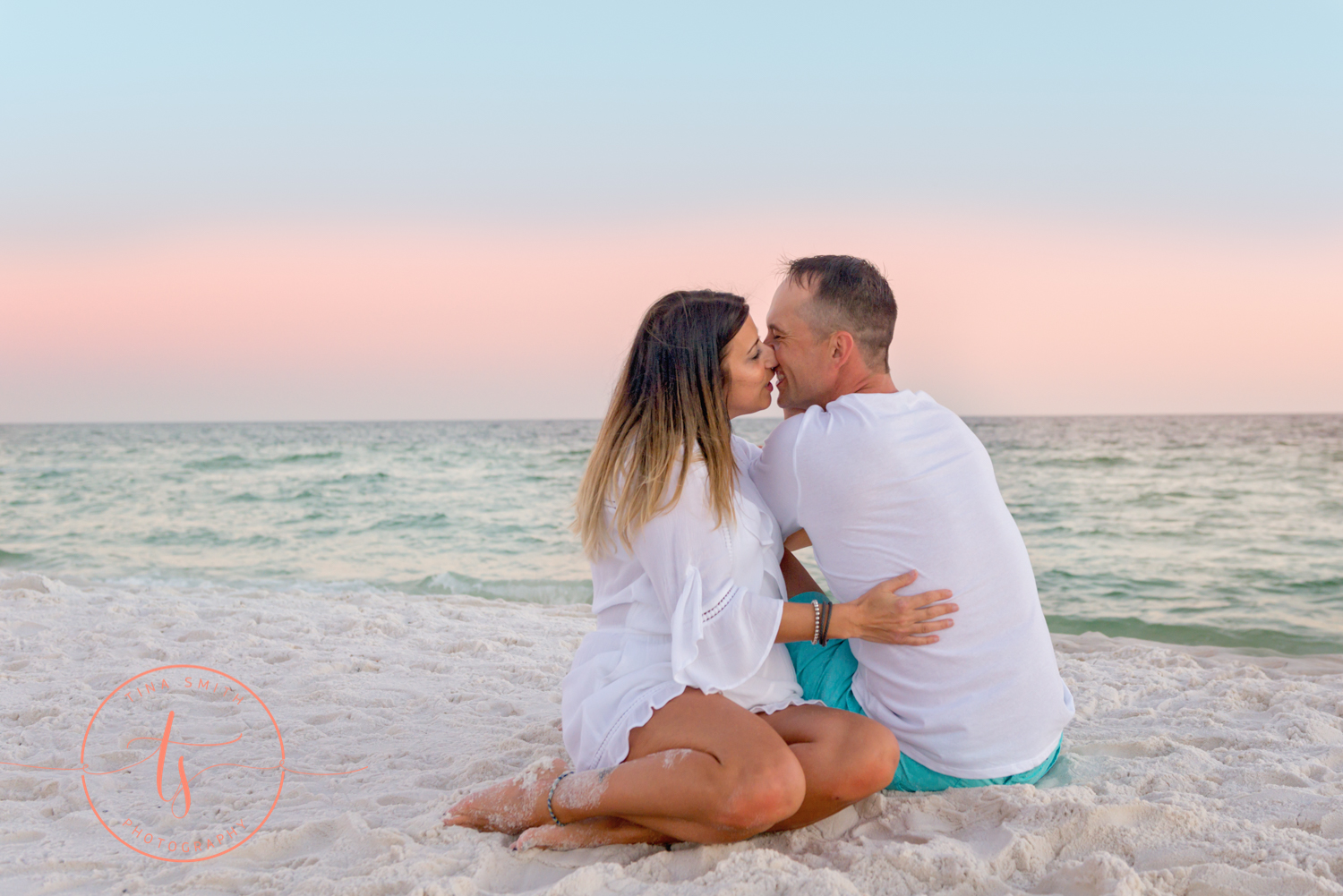 couple kissing on beach in destin for portraits
