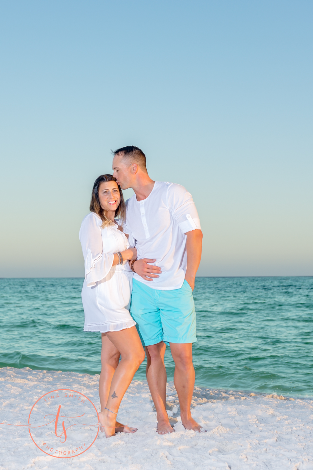 couple posing on beach for portraits