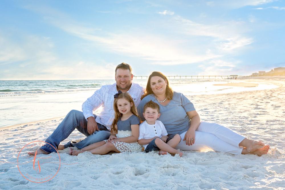 family sitting on beach for destin family beach photography