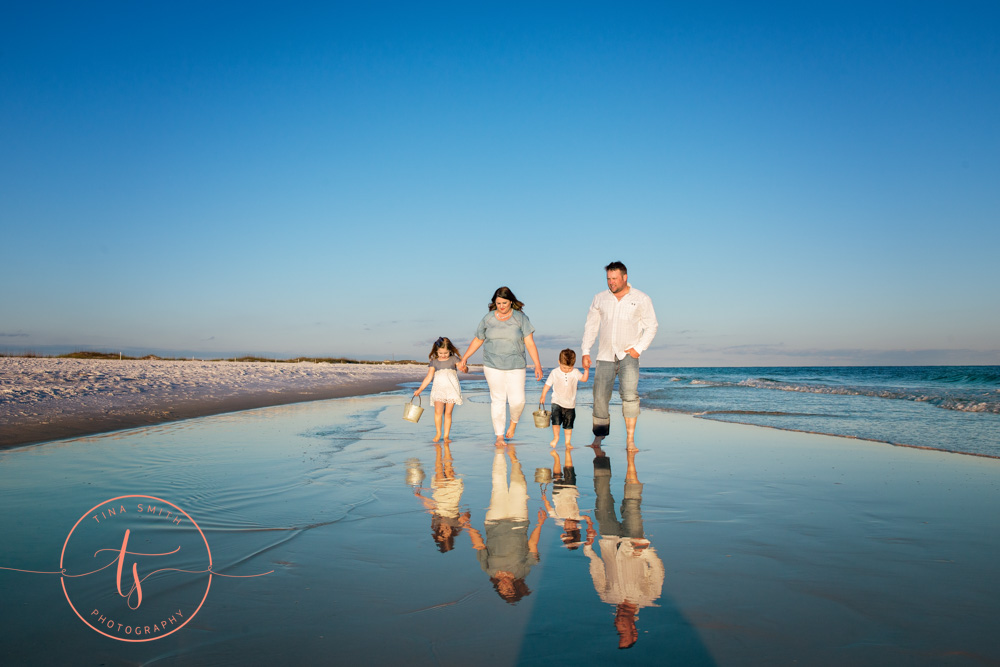 destin family walking down beach for photography