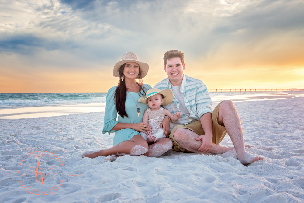 family sitting on beach in destin