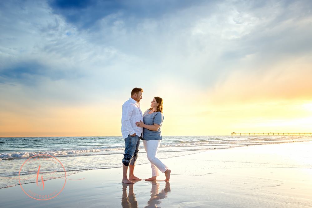 couple standing on beach in destin at sunset