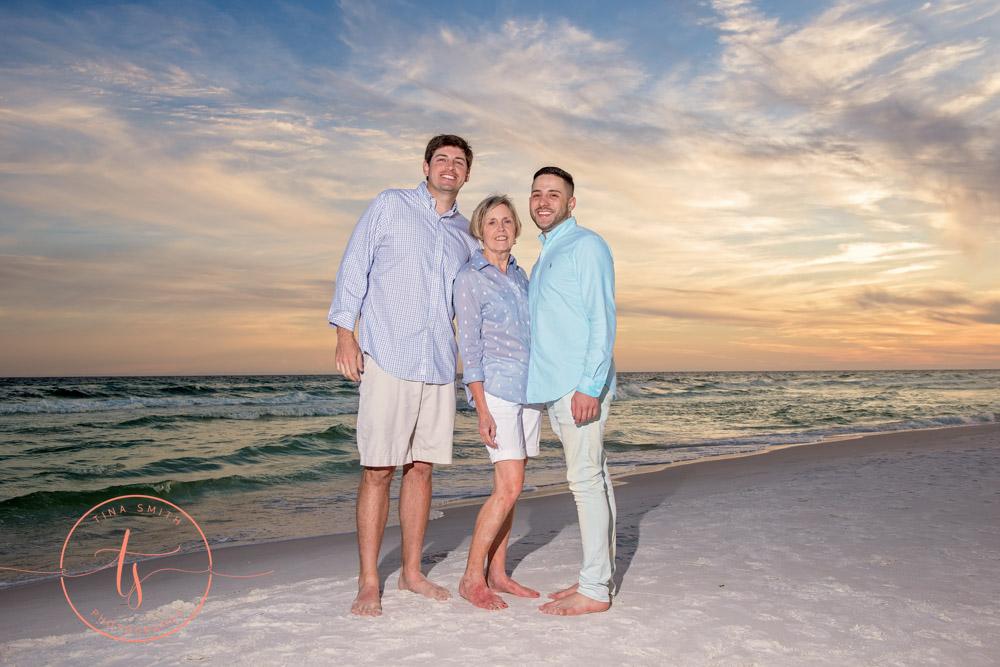 family posing on beach in miramar