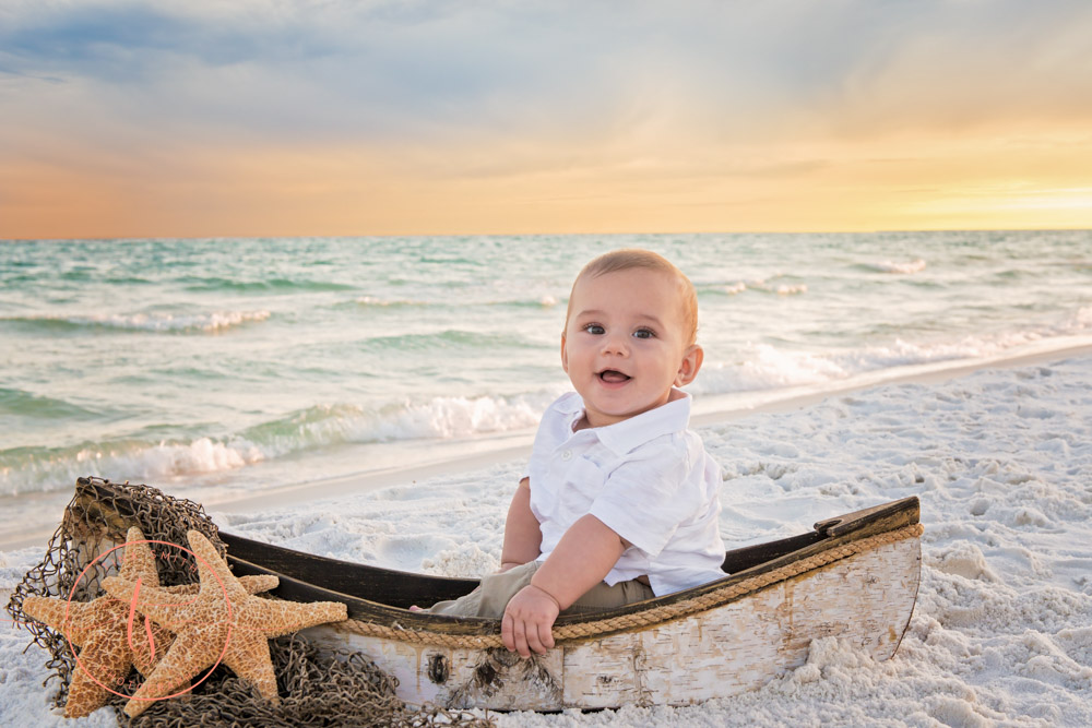 destin photographer boy in boat on beach