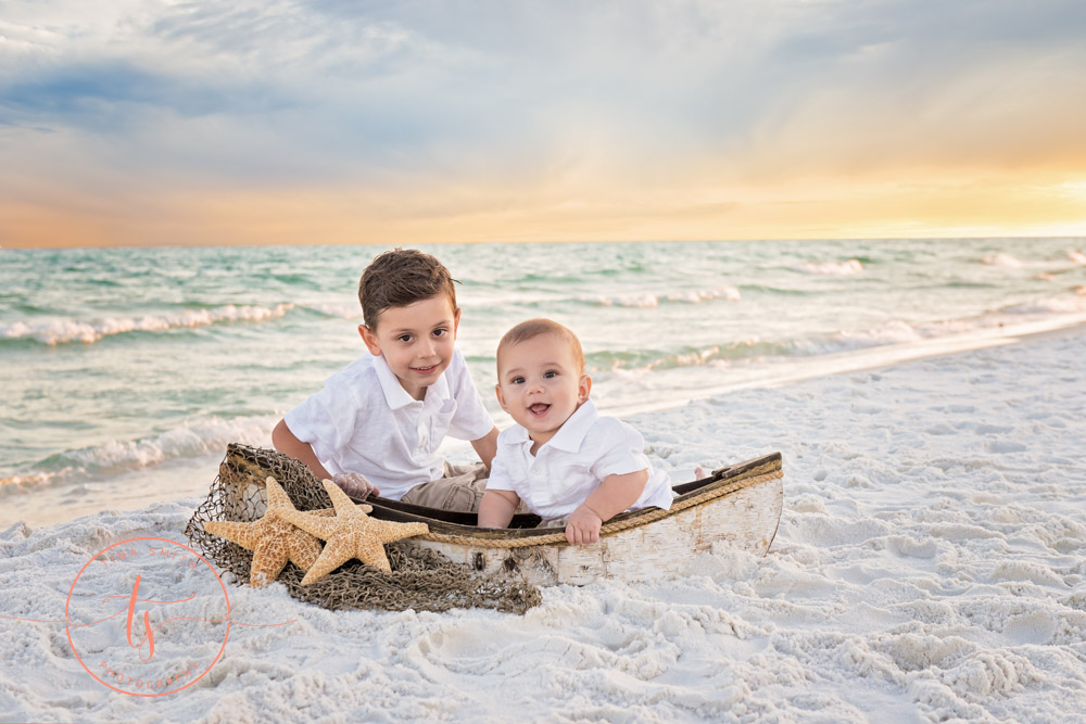 destin photographer two boys on beach in boat