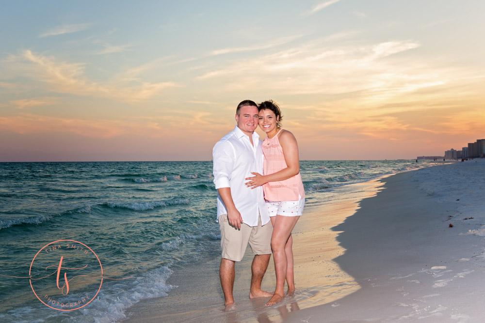 couple posing on beach for destin photographer