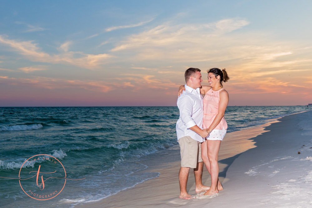 couple on beach posing for destin photographer at sunset