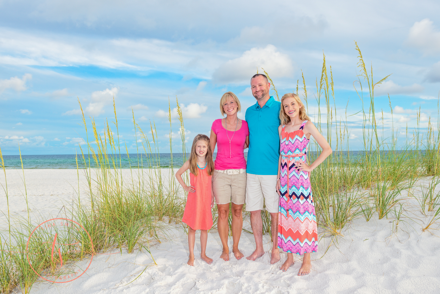 family standing in front of sea oats on the beach is destin for family photography