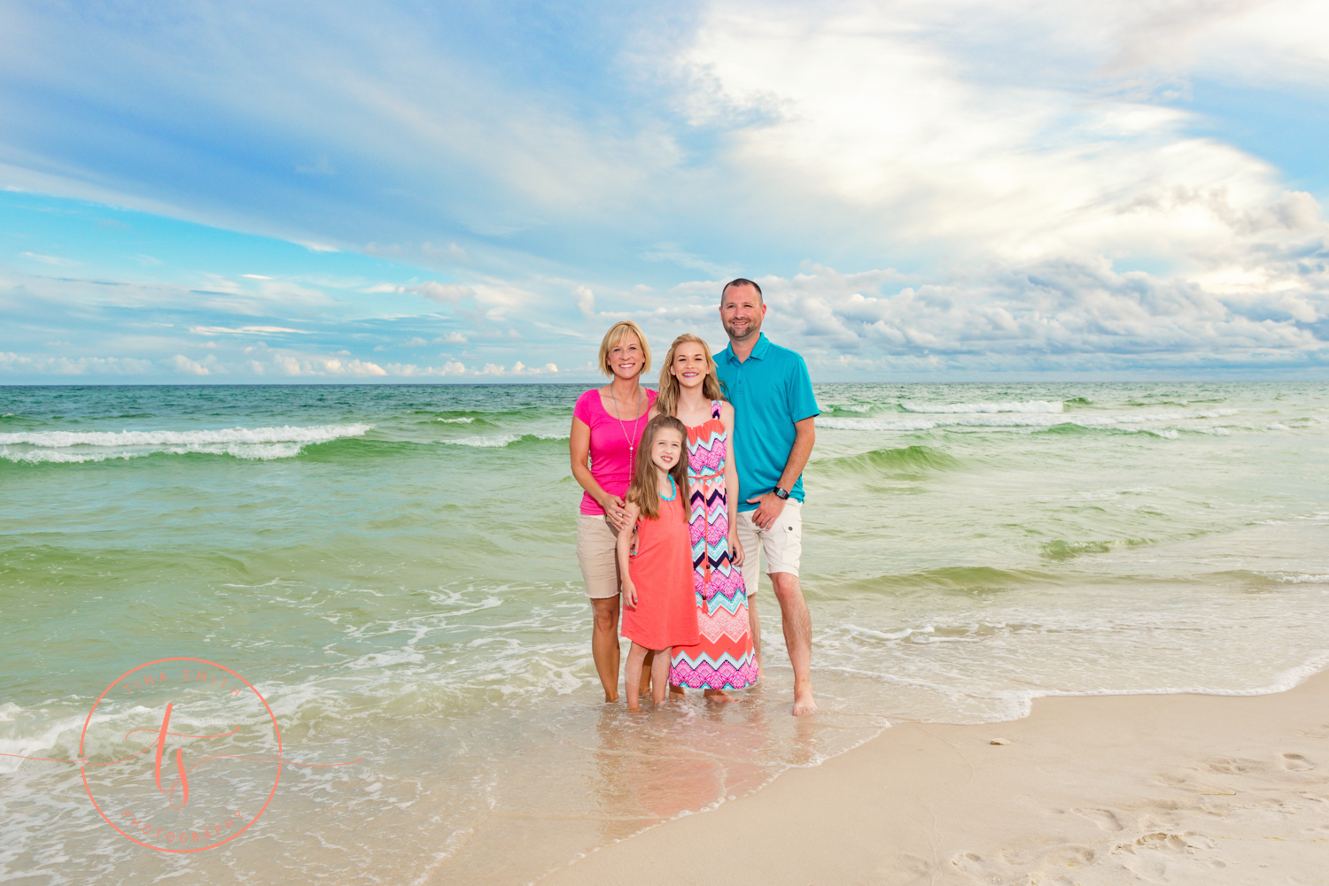 destin family beach photography posing in the waters edge