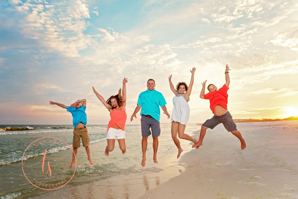 family jumping in the air on destin beach