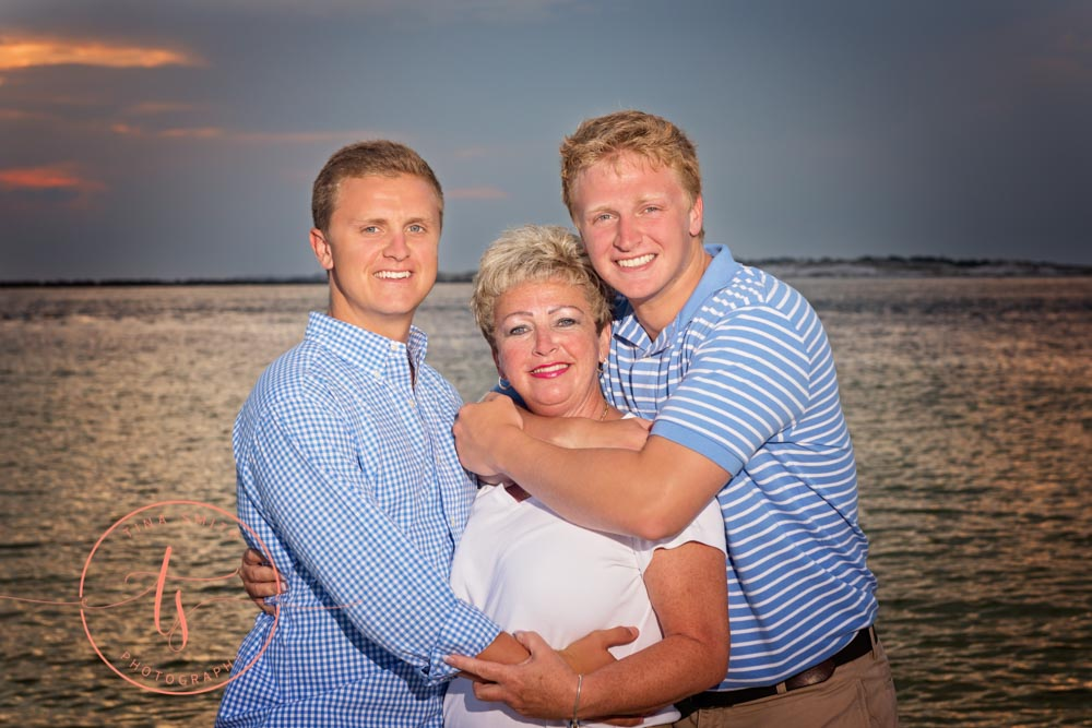 mom and sons posing for family portrait in destin