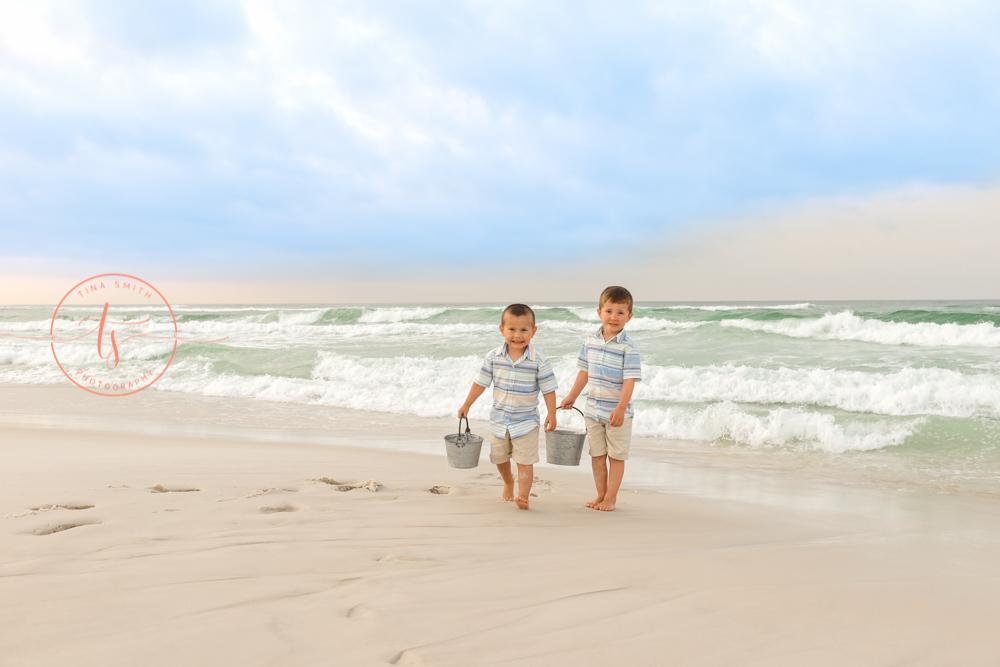 boys with buckets on the beach in destin