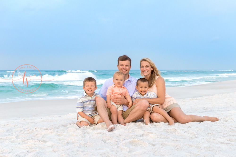 family sitting on the beach in destin