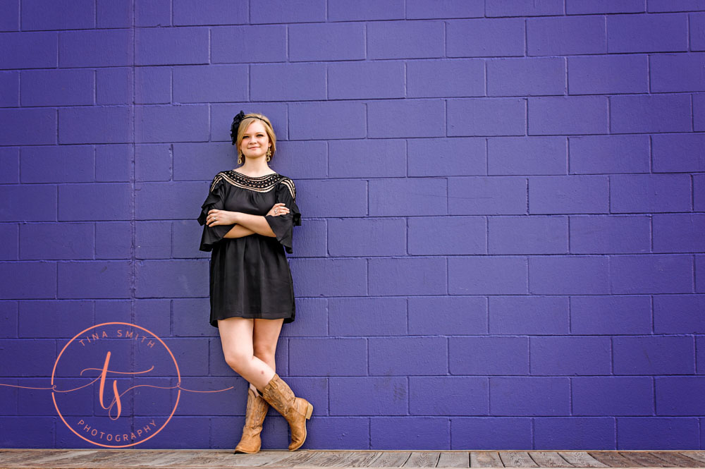 seaside purple wall senior portraits