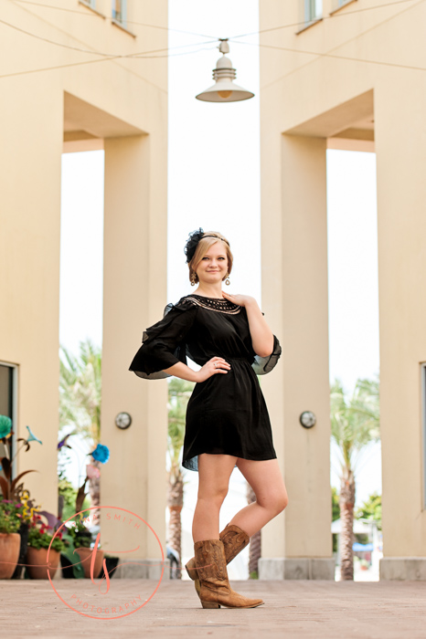 senior portrait of girl in black dress in seaside