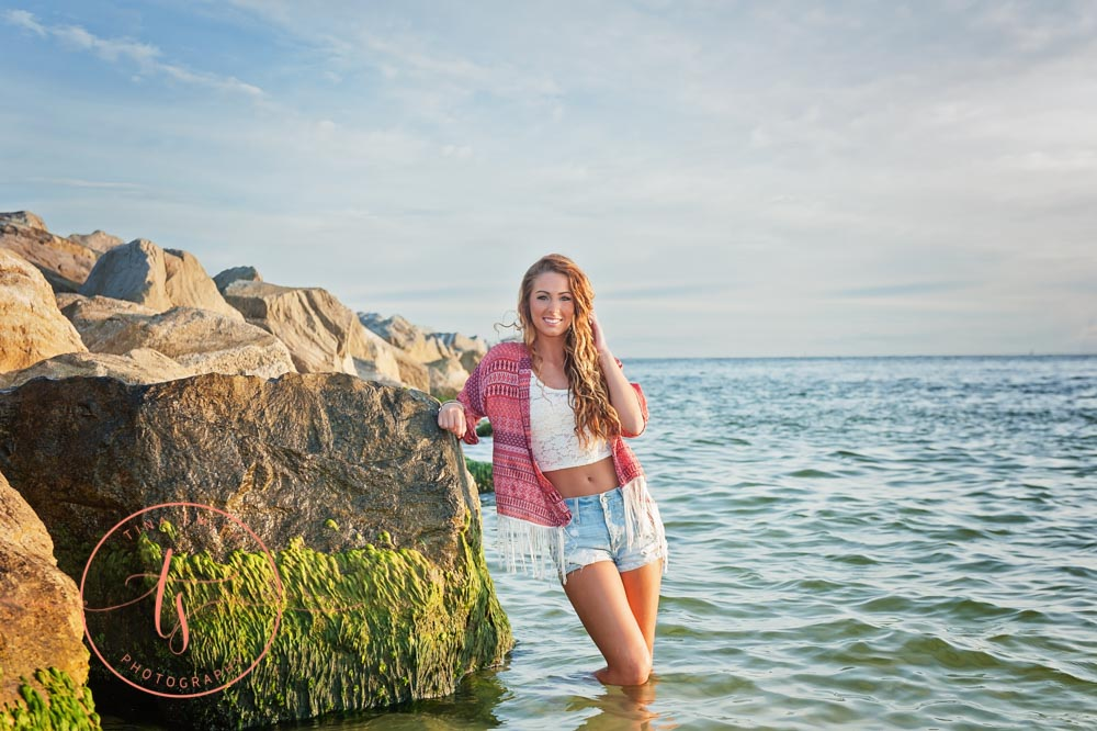girl posing for destin senior photographer in the water