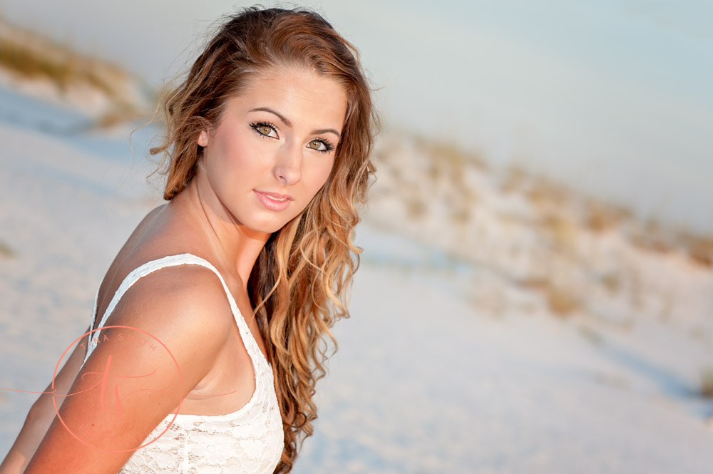 senior girl posing on the beach in destin