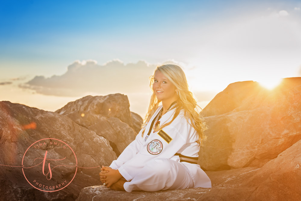senior girl posing in black belt karate outfit