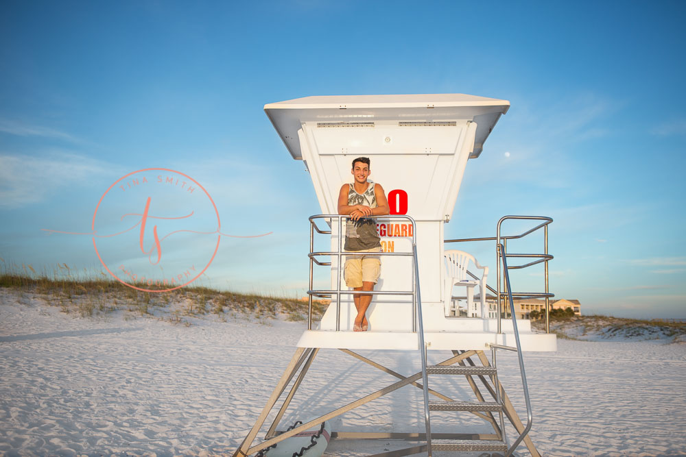 destin senior portraits photographer boy standing on the life guard stand
