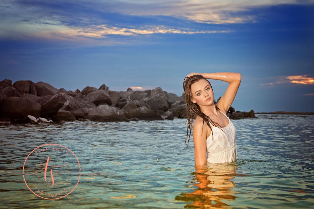 senior girl on destin beach posing for portraits
