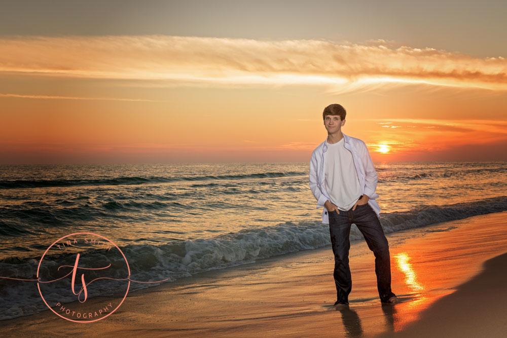 senior boy posing for photographer ft walton beach sunset