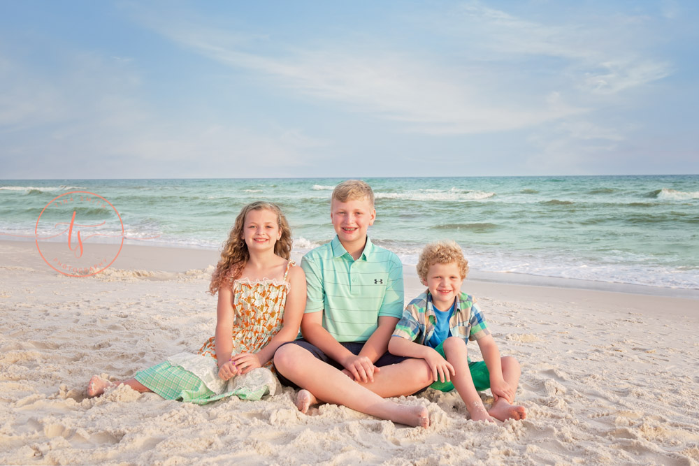 children sitting on rosemary beach