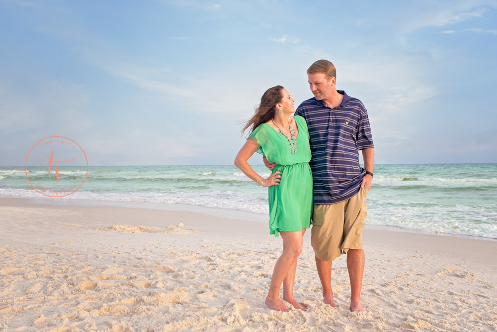 couple standing on rosemary beach posing for photographer