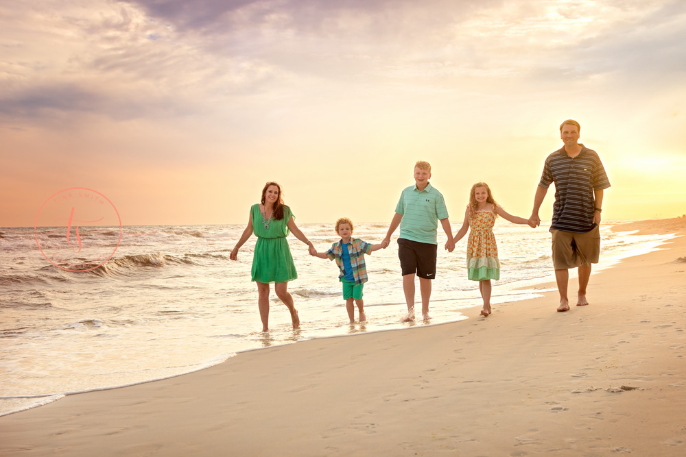 family walking on the beach rosemary beach photographer