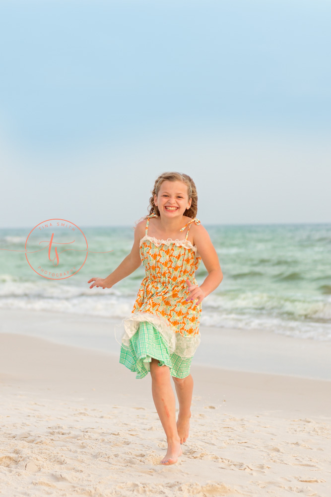 girl running on the beach rosemary beach photographer