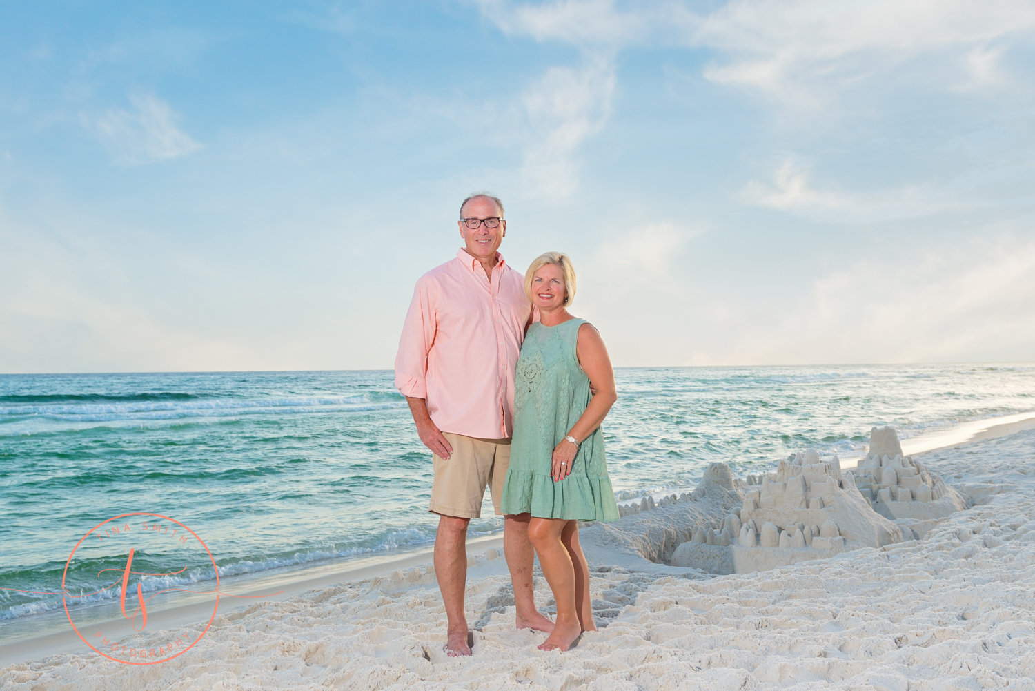 couple posing on the beach in seacrest for portraits