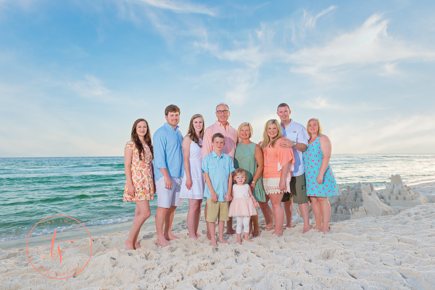 secrest family beach photography posing at waters edge