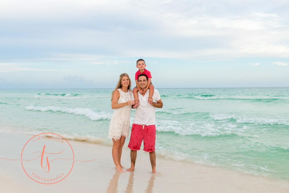 family posing on beach in seacrest